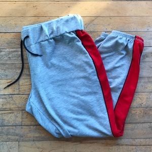 Grey jogger pants with red stripe, Target, cropped